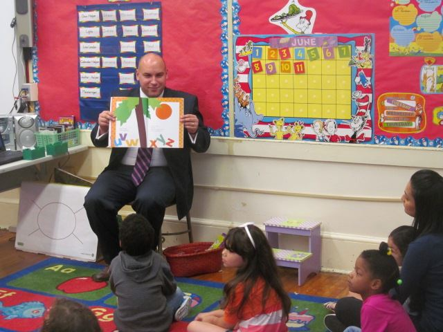 Mayor Venezia Shows Pictures of Storybook to Carteret School Children in July 2014